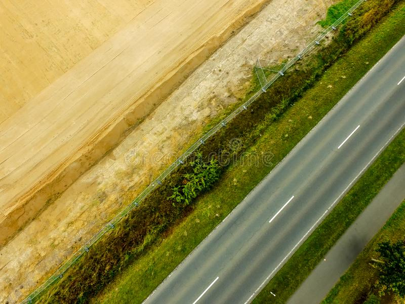 Graphic and abstract aerial view of the vertical photograph of a road with markings between fields. Germany royalty free stock photography