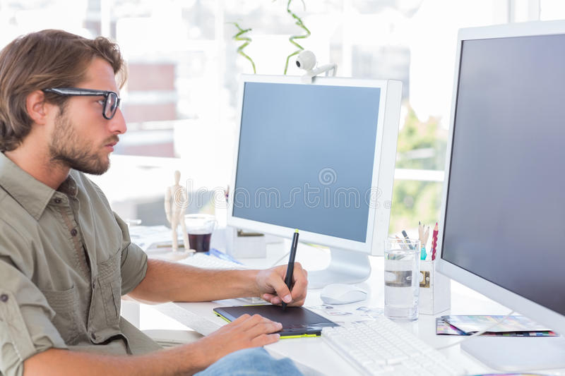 Graphic artist using graphics tablet royalty free stock photos