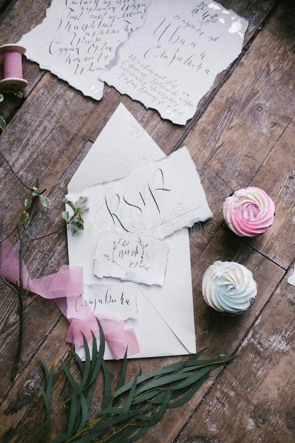 Graphic arts of beautiful wedding calligraphy cards with two mini cakes and pink chiffon ribbon. stock photo
