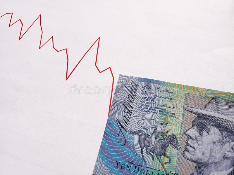 Graphic with descending line and australian banknote of ten dollars. Backdrop for announcements of trading and exchange, bank and commerce, price of buy and sell stock photos