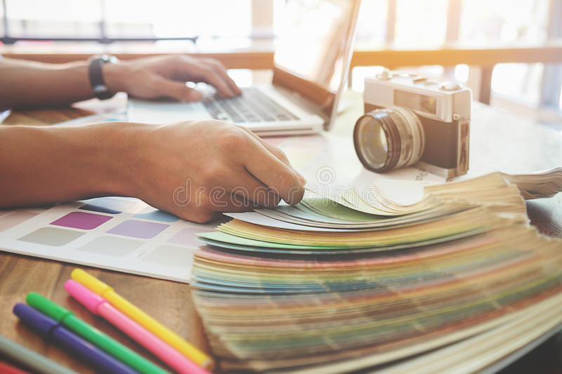 Graphic design and color swatches and pens on a desk. Architectural drawing with work tools and accessories. stock images