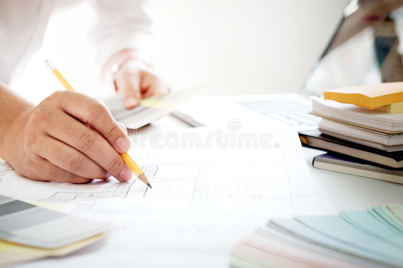 Graphic design and color swatches and pens on a desk. Architectural drawing with work tools and accessories. royalty free stock photo