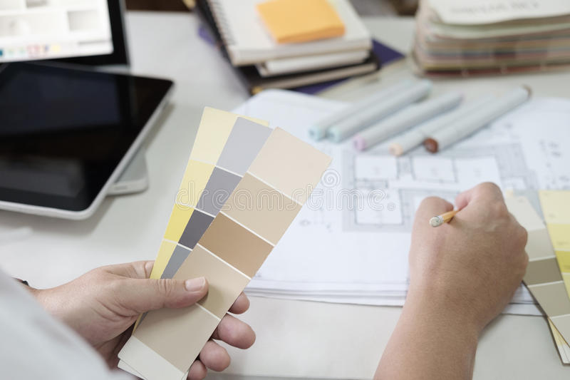 Graphic design and color swatches and pens on a desk. Architectural drawing with work tools and accessories. royalty free stock image