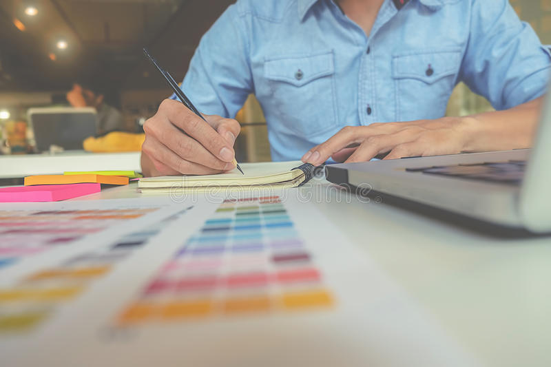 Graphic design and coloured swatches. And pens on a desk royalty free stock photos
