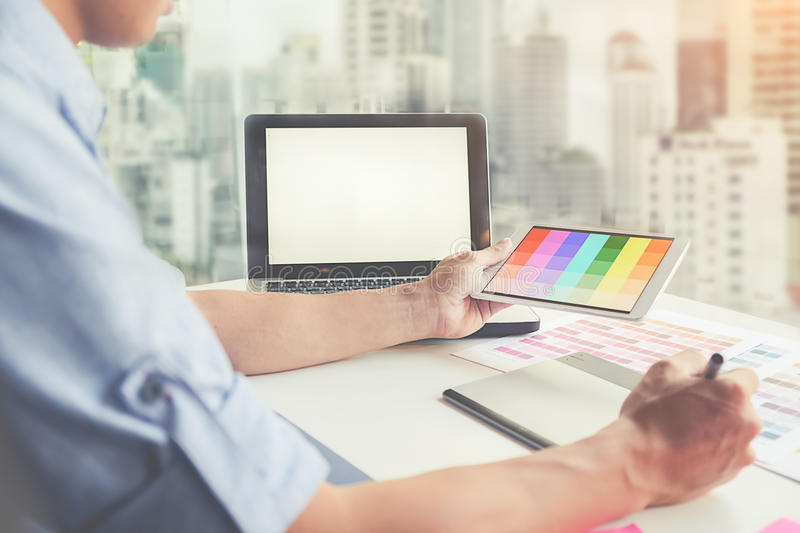 Graphic design and coloured swatches. And pens on a desk royalty free stock photo