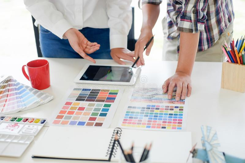 Graphic design meeting with tablet computer on workplace. royalty free stock images