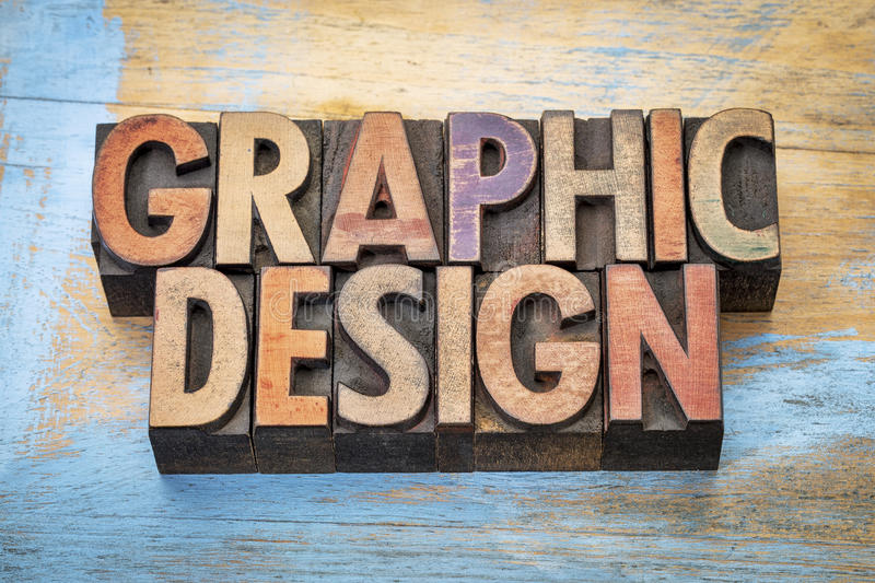 Graphic design word abstract in wood type. Graphic design - word abstract in vintage letterpress wood type printing blocks against grunge wood royalty free stock image