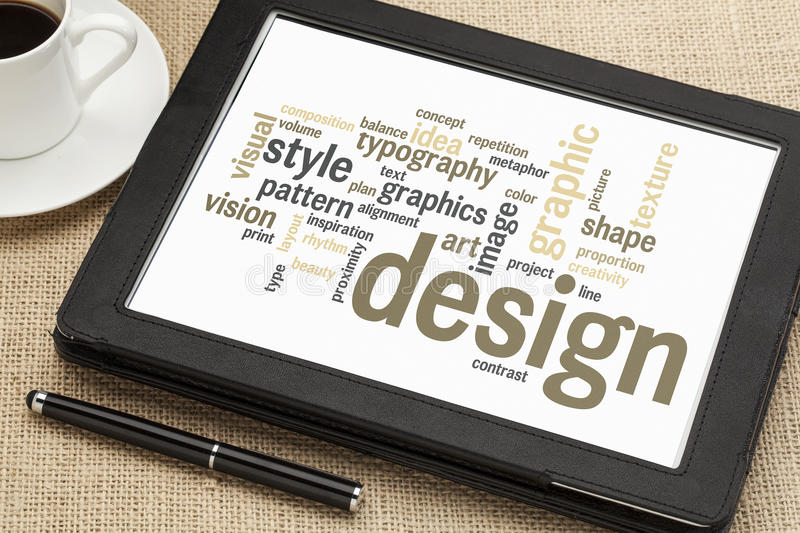 Graphic design word cloud. Cloud of words or tags related to graphic design on a digital tablet with a cup of coffee stock images