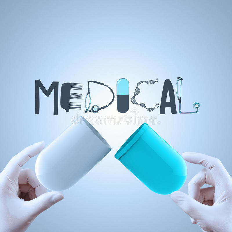 Graphic design word MEDICAL as concept. Hands open capsule show graphic design word MEDICAL asl concept stock photography