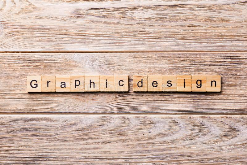 Graphic design word written on wood block. graphic design text on wooden table for your desing, concept.  royalty free stock photos