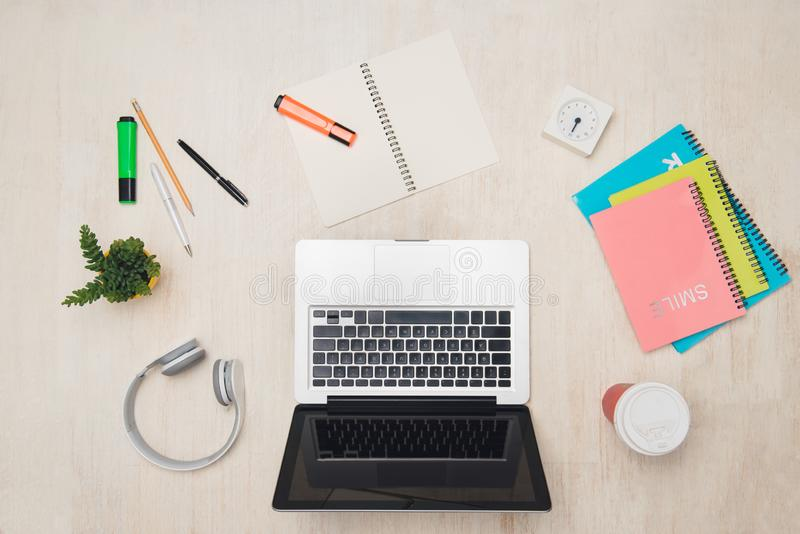 Graphic designer desk essentials top view with wooden texture background.  royalty free stock photo