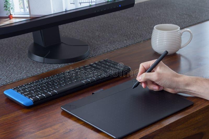 Graphic designer hand with stylus pen stock image
