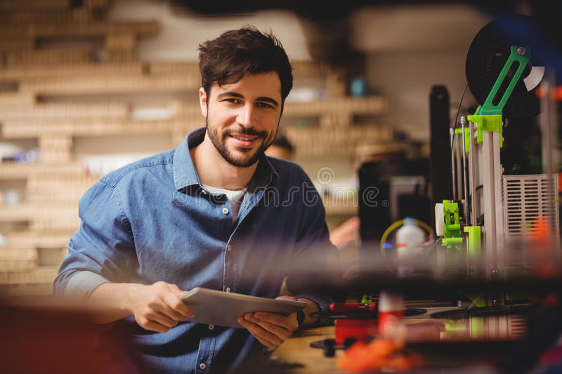 Graphic designer holding digital tablet royalty free stock photos