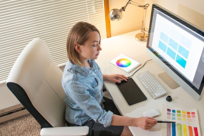 Artist Creative designer.web development.work with color.flane Illustrator Graphic skill concept. Graphic designer sitting at work. Illustrator. web designer royalty free stock image