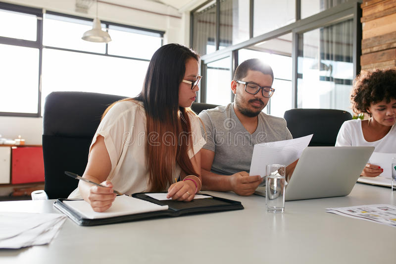 Graphic designer using digital graphics tablet and desktop stock photos