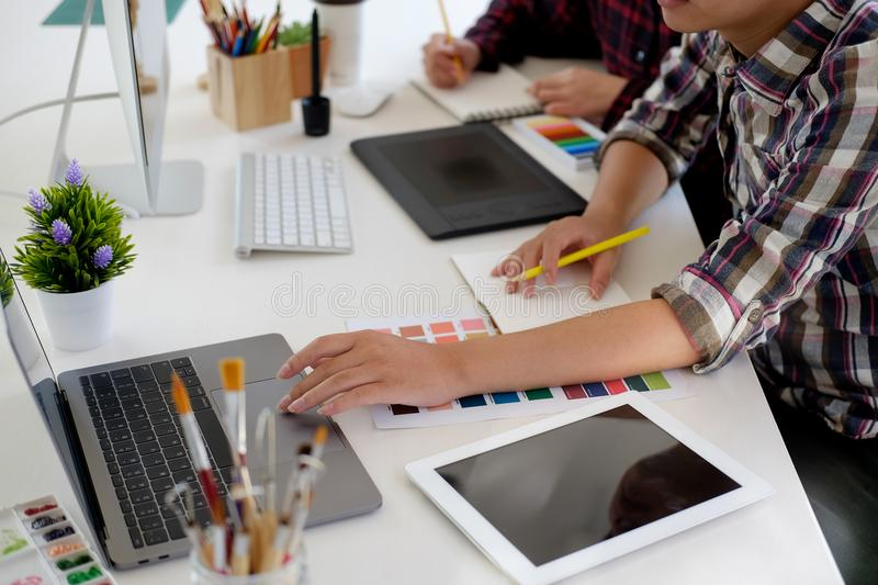 Graphic designer using digital tablet and computer royalty free stock photography