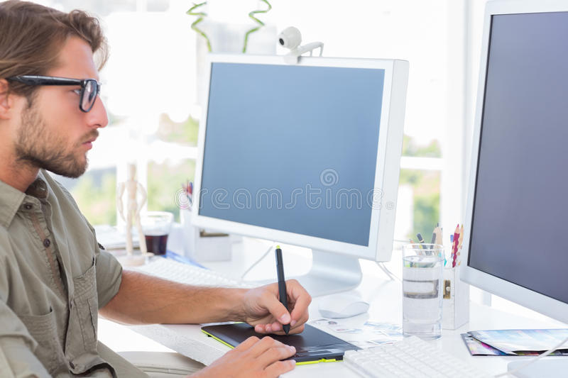 Download Graphic Designer Using Graphics Tablet Stock Photo - Image: 31009724