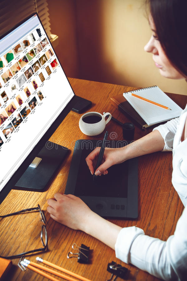 Graphic designer using tablet. View of an artist drawing something on graphic tablet at the office stock photo
