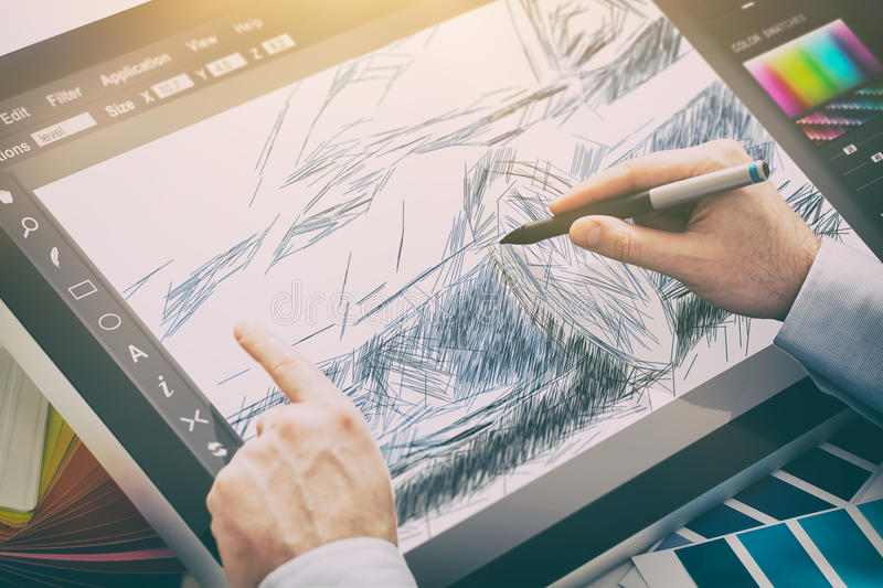 Graphic designer at work. Color samples. Designer graphic drawing car creative creativity draw work tablet screen sketch designing coloring concept - stock stock photo