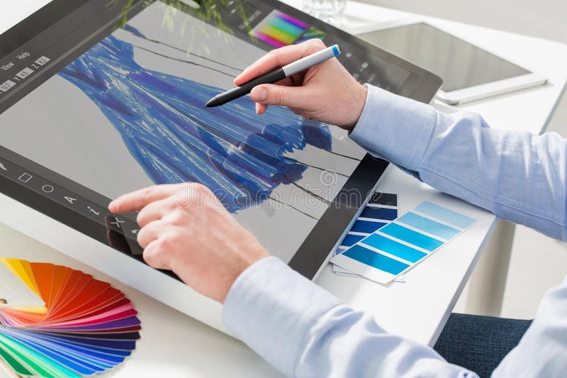 Graphic designer at work. Color samples. Fashion fashionable designer clothing clothes cloth sketch design designing drawing draw stylist man male blue concept stock photos