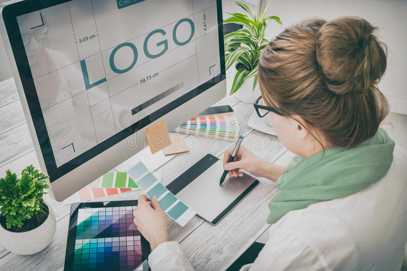 Graphic designer at work. Color samples. stock images