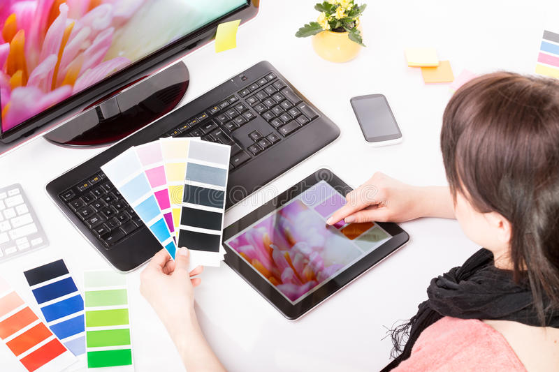 Graphic designer at work. Color samples. royalty free stock images
