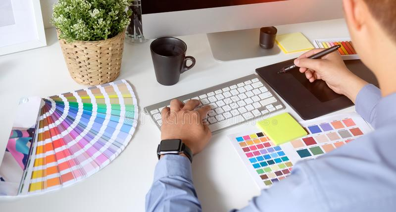 Graphic designer working with drawing tablet stock photography