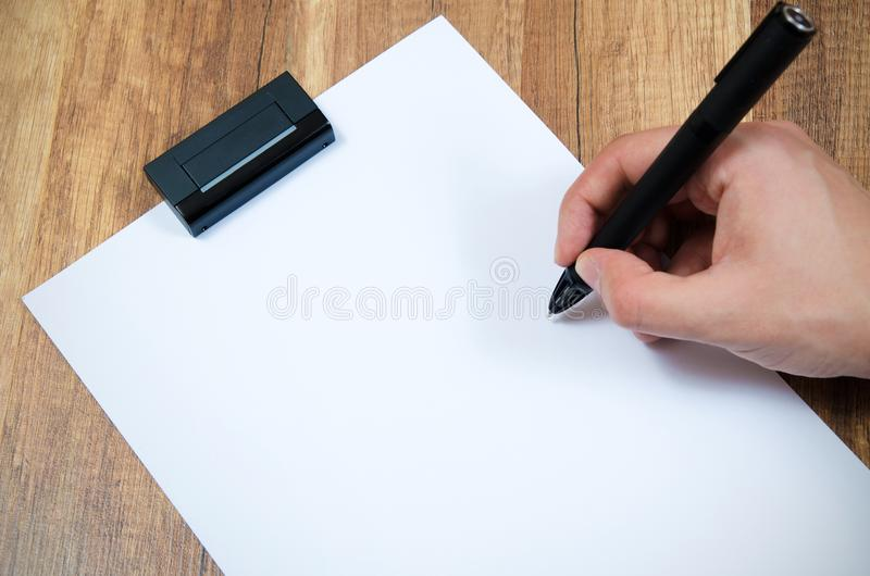 Graphic designer working with modern digitized pen. Composition on wooden background royalty free stock photography