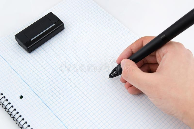 Graphic designer working with modern digitized pen. With wireless scanner royalty free stock image