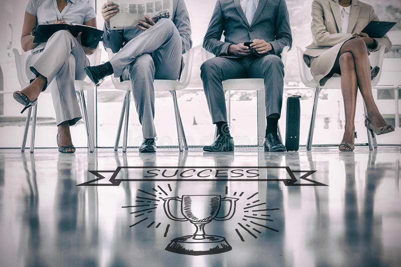 Composite image of graphic image of success text on banner over trophy. Graphic image of success text on banner over trophy against group of well dressed stock photo