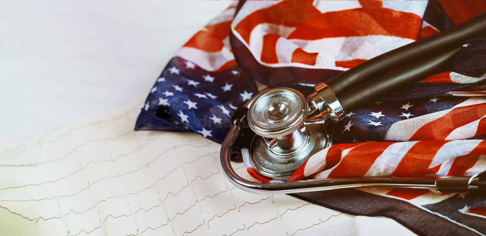 Graphic print of cardiogram measuring heart beats Stethoscope on US flag royalty free stock photo