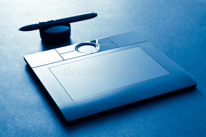Graphic tablet on blue stock images