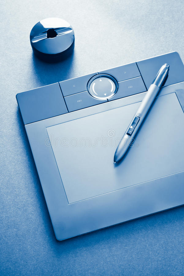 Graphic tablet in blue royalty free stock photo