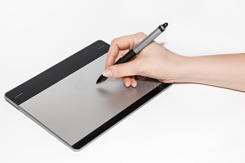 Graphic tablet, hand and feather stock photos