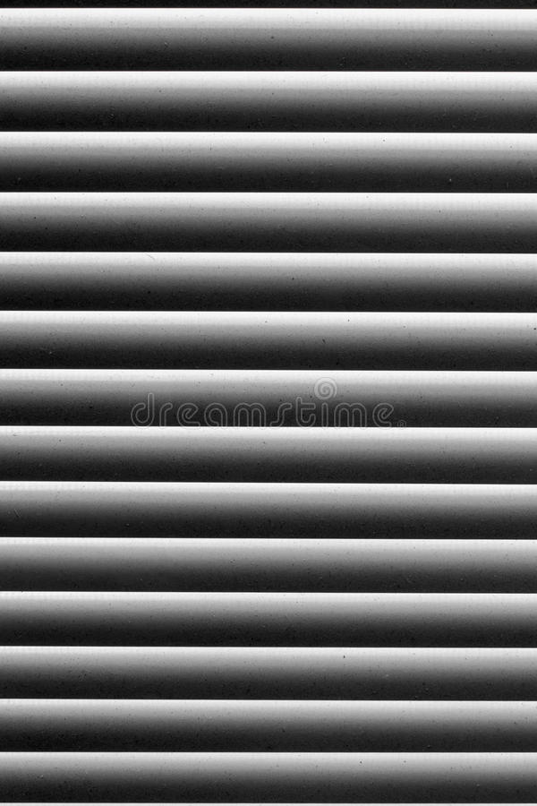 Graphic texture in black and white abstract striped pattern. Blinds on the window with the dust on the light strips.  royalty free stock image