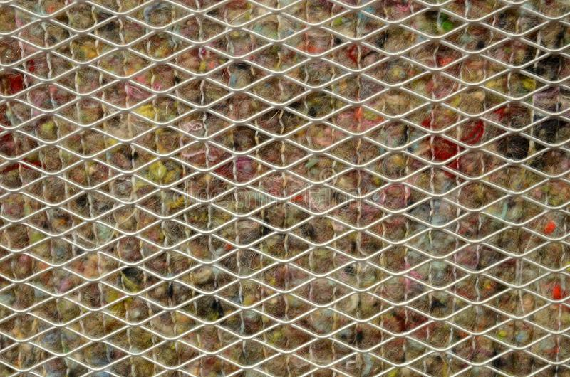 The graphical resource consists of a metal grating on felt. The graphical resource consists of a metal grating on felt, like a heater stock photos
