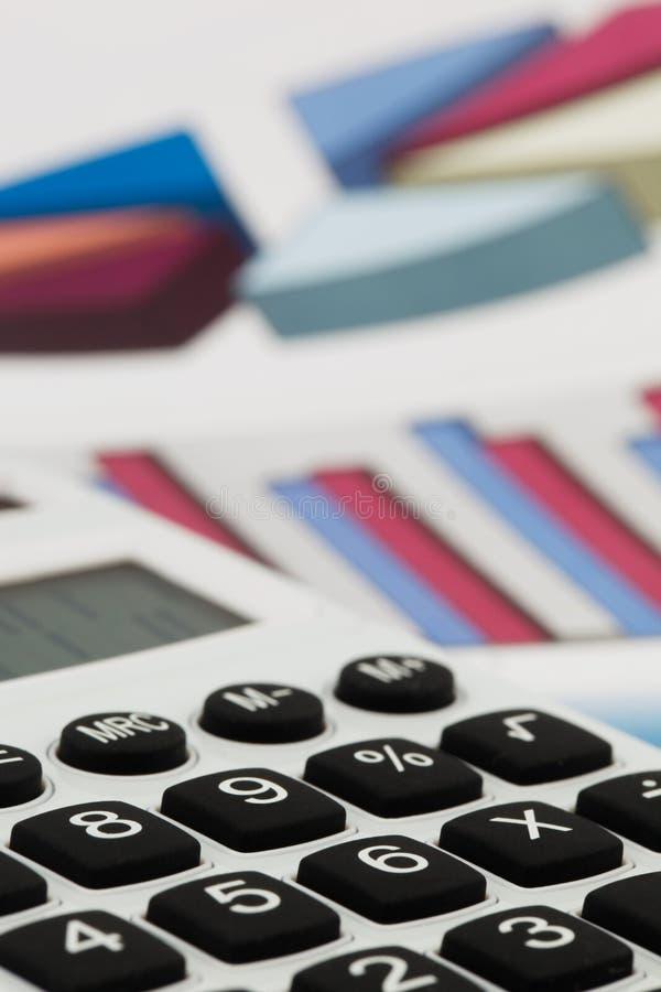 Graphics calculator and a balance sheet stock photo