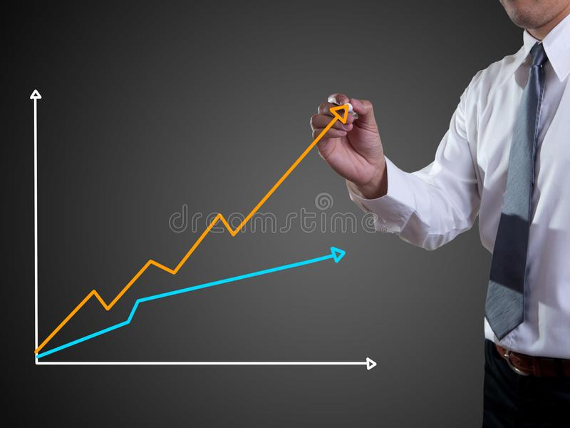 Graphs. Business man hand drawing a graph, shares, market, leadership, isolated, forecasting, copy, white, achievement, sketching, future, consultant, blank royalty free stock photography