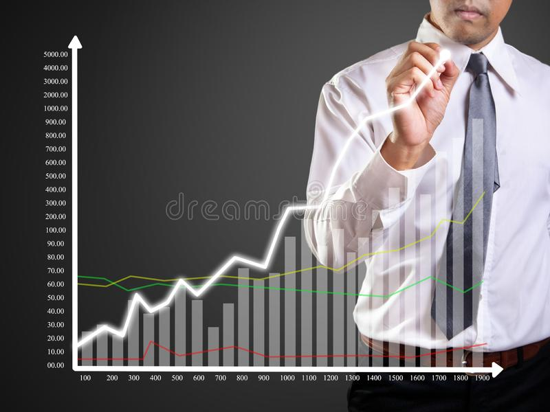Graphs. Business man hand drawing a graph, shares, market, leadership, , forecasting, copy, white, achievement, sketching, future, consultant, blank, whiteboard royalty free stock photos