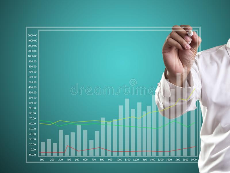 Graphs. Business man hand drawing a graph, shares, market, leadership, , forecasting, copy, white, achievement, sketching, future, consultant, blank, whiteboard stock image