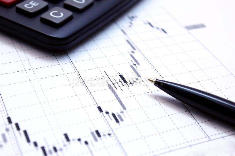 Graphs, calculator and pen. royalty free stock image