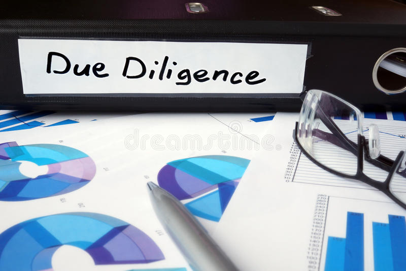 Graphs and file folder with label Due Diligence. Business concept stock photography