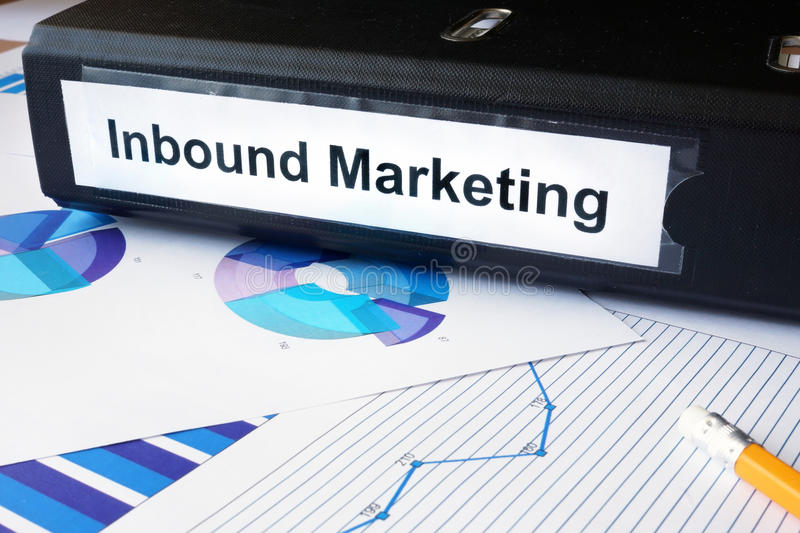Graphs and file folder with label Inbound Marketing. stock images