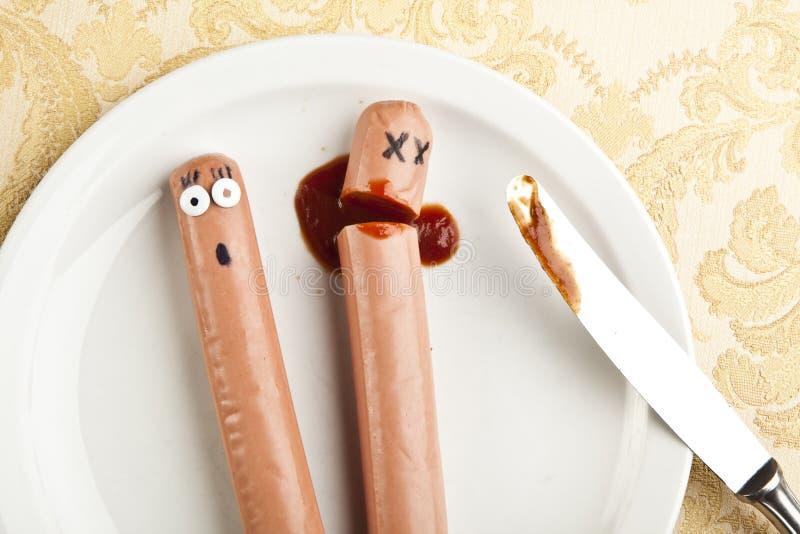 Grappig beeld van moorde hotdog royalty-vrije stock afbeeldingen