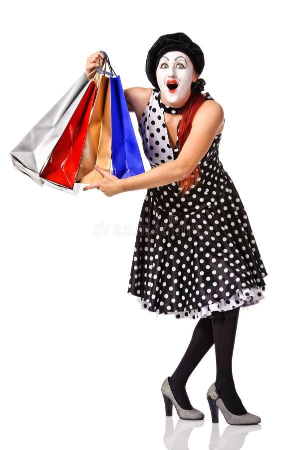 Grappig boots in spotty kledingsholding het winkelen zakken na stock fotografie