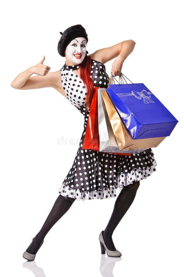 Grappig boots in spotty kledingsholding het winkelen zakken na royalty-vrije stock fotografie