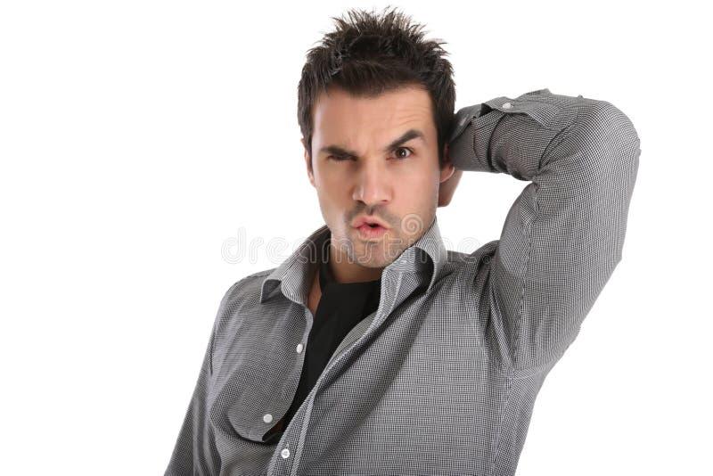 Grappig gezicht van een knappe mens stock foto's