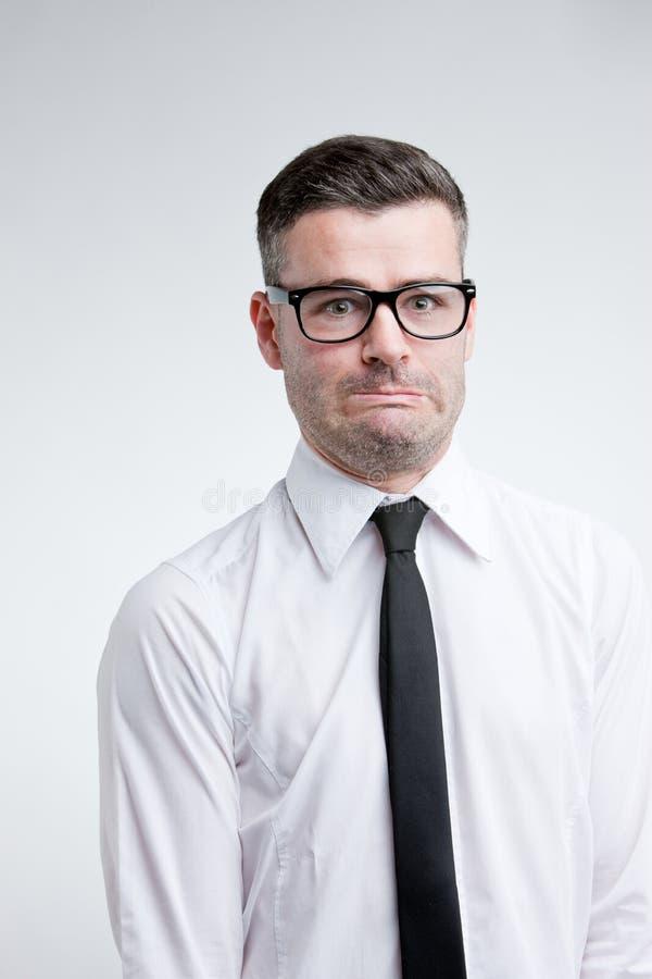 Grappig gezicht van een ongerust gemaakte schuldige mens royalty-vrije stock foto's