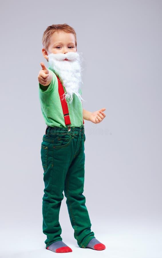 Grappig jong geitje de Kerstman met duim op vinger stock fotografie
