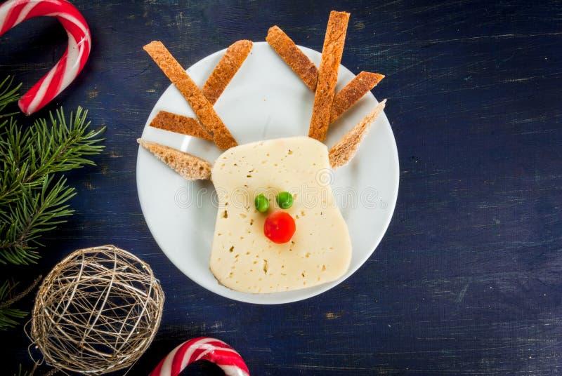 Grappig Kerstmisvoedsel voor jonge geitjes stock fotografie